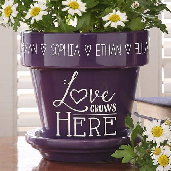 "Meaningful gifts for Mom - Brighten Mom's day with this sweet ""Love Grows Here"" flowerpot that features her childrens' names etched around the top.  A beautiful addition to her porch, patio, or kitchen!"